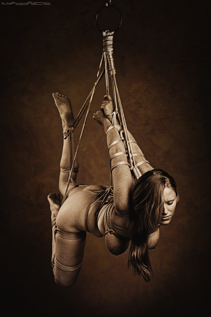 Black rope suspension bdsm
